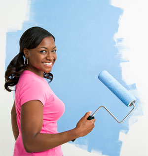 Woman Painting Wall in Garage